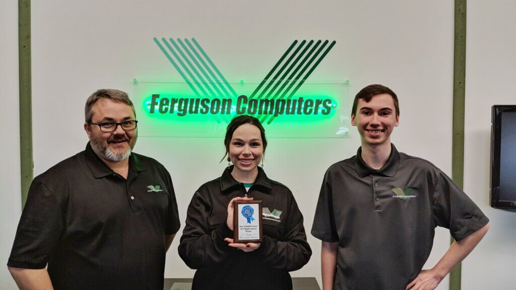 Ferguson Computers Staff holding a plaque